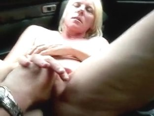 xh golden-haired playing in car