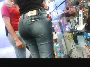 Brunette with big round ass in tight jeans