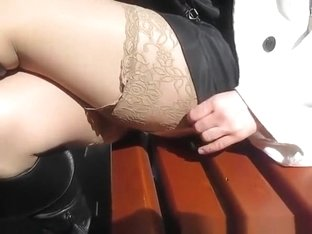 Woman in black boots and stockings