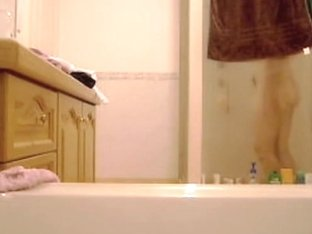Laura in the bathroom strips and gets booty voyeured