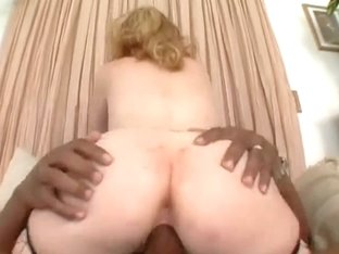 Redhead twat screwed by a large darksome strapon