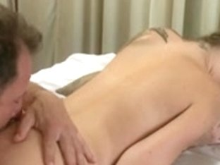 Cute tattoed girl receives naked massage from horny man