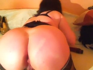 Lady with huge bust fucks herself