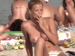 Filming some natural boobs at a beach
