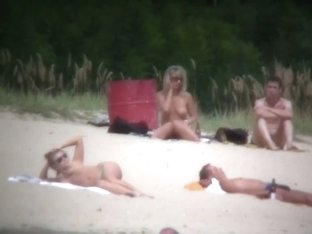 Busty blonde nude beach MILF spied on by a voyeur