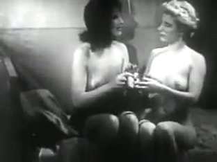 Vintage girls playing with dildo.