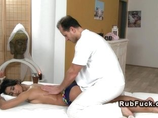 Tanned beauty fucks masseurs cock
