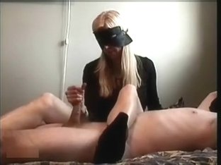 Lady Bandit gives a great hand job blind folded to a slave
