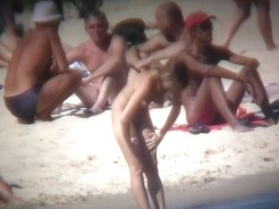 Nude couple relaxing on the beach and filmed by spy cam