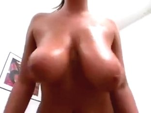 Amateur bitch plays with her tremendous tits in homemade clip