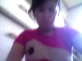 Cute Filipina woman flashing her perky breasts on web camera