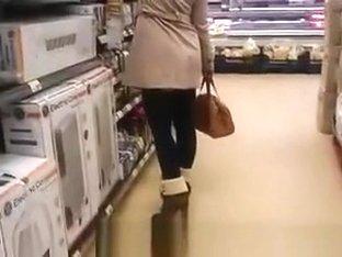 Woman in short dress supermarket upskirt