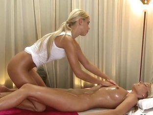 Naked masseuse giving massage to sexy blonde