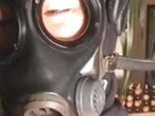 jizz flow on woman in gasmask