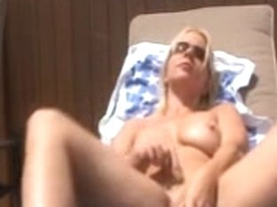 Blonde got caught toying herself on the backyard