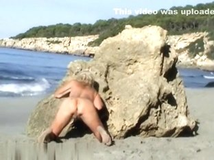Beach chick bangs her love button with finger