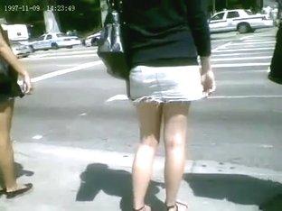 Nice legs, tiny denim skirt going up the escalator