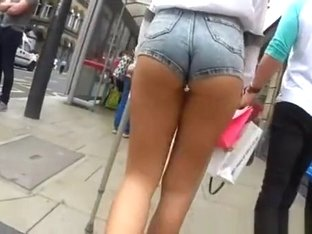 Girl walking with crutches tight shorts