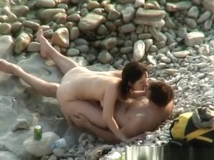 Nudist woman posing for her man taking pictures