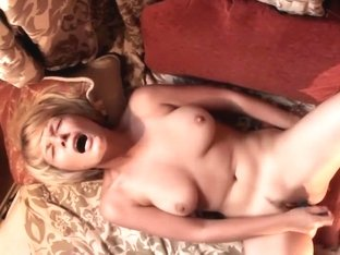 Blonde girl caught playing with a dildo