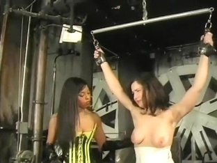 Horny ebony mistress punishes a brunette slave's juicy curves