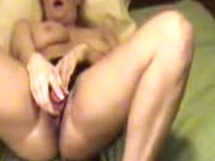 Young babe fucking her wet cunt with a pink huge dildo