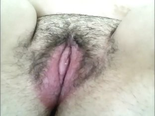 Hot brunette milf toys her wet hairy pussy in solo