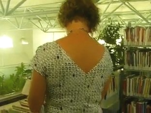 MILF upkskirt in the library