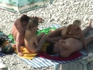 Two nudist couples spied in the beach