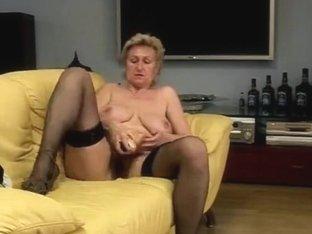 granny masturbating on bed