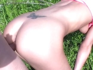 A blossoming meadow and undressed pair fucking in the centre