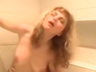 Breasty blond having enjoyment in the bath