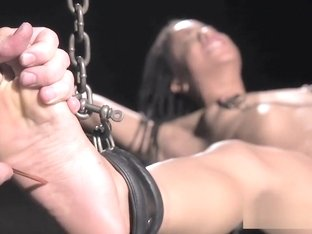 Ebony slave chained gets tormented