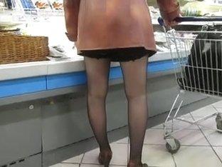Black stockings upskirt in supermarket 1