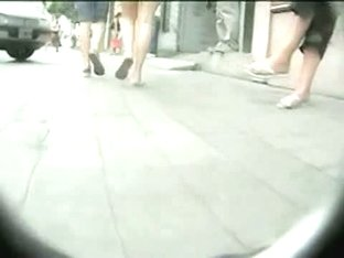 Girl in flip-flops shows her ass on the candid camera