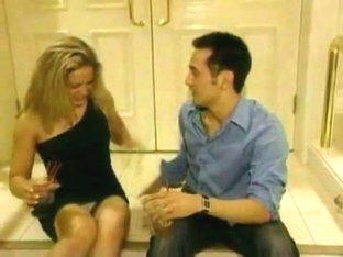 A seductive couple enjoying wine