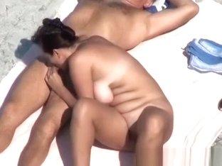 Couple blowjob at beach