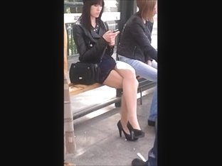 Girl with sexy legs in mini skirt and high heels