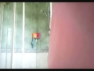 Voluptuous European with short red hair showers in a voyeur porno vid