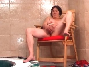 Over 70 granny with hirsute bawdy cleft copulates a vibrator