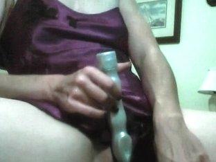Vibrator on sexy MILF in nightgown