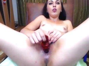 Brunette Adelmyra fucks herself with rubber dildo
