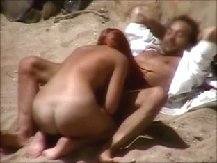 Sex on the beach with hot redhead
