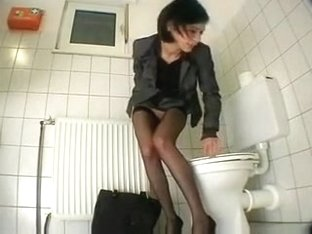 secretary masturbates with dildo at the restroom