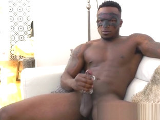 Tattooed ebony stud plays with a fleshlight and wanks alone