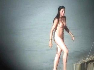 Long black hair nudist woman