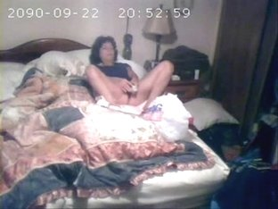 Hidden cam catches milf masturbating on bed
