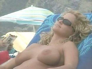 Beach beauties hang out naked below the sun