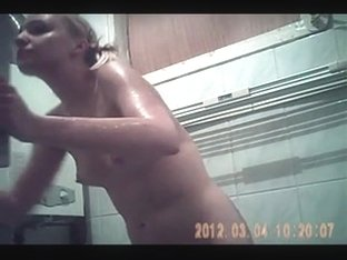Hidden cam caught her face and tits in bath