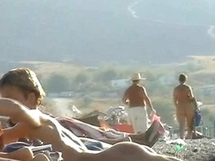 Nudist beach as always gets some extra voyeur's attention